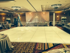 White dance floor and head table draping