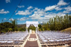 Ceremony with our clear ghost chiavari chairs in Orange County Mansion